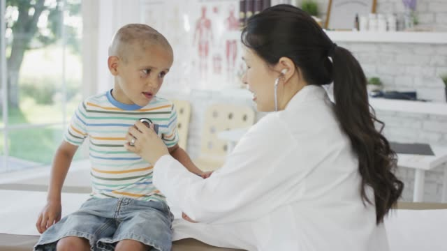 using a stethoscope - paediatrician stock videos & royalty-free footage