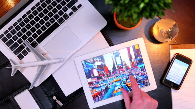 Using a tablet, smartphone, and laptop for travel planning