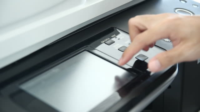 using an office printer - photocopier stock videos and b-roll footage