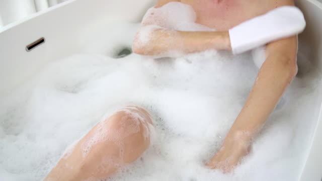 using bath glove - exfoliation stock videos & royalty-free footage