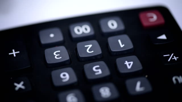 using calculator|dealing with finance - accountancy stock videos & royalty-free footage