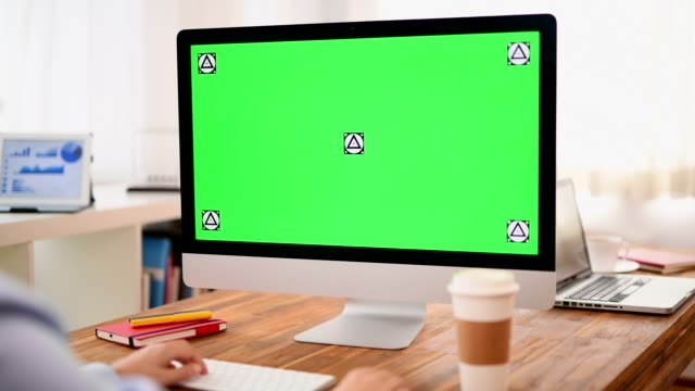 using chroma key screen desktop computer at office - over the shoulder view stock videos & royalty-free footage