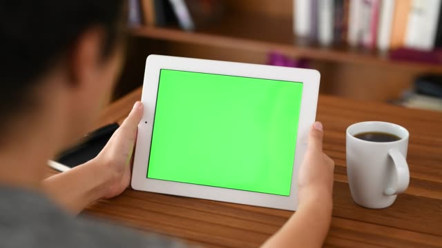 using chroma key screen tablet pc - over the shoulder stock videos & royalty-free footage