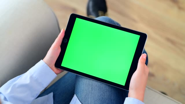 using chroma key screen tablet pc - green colour stock videos & royalty-free footage