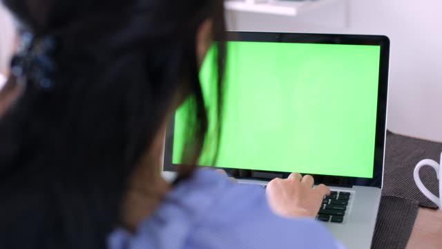 using computer at bed room ,chroma key - looking at camera video stock e b–roll