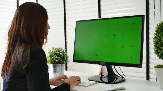 using computer green screen in modern office - desktop pc stock videos & royalty-free footage