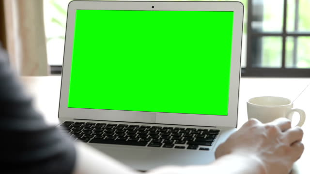 using computer with green screen (hd) - computer monitor stock videos & royalty-free footage
