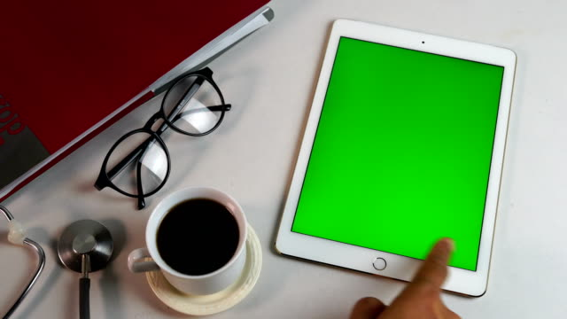 ws:using digital tablet, green screen - over the shoulder stock videos & royalty-free footage