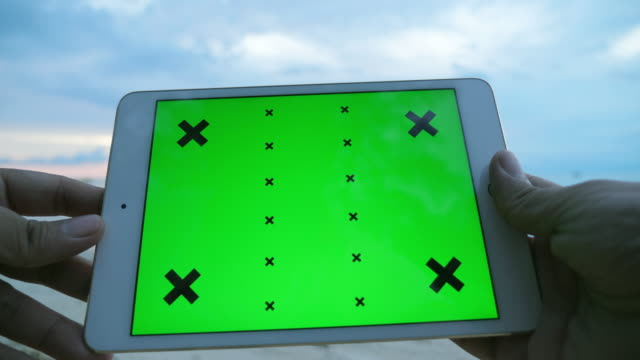 using digital tablet on the beach at sunset, green screen, chroma key - outdoors stock videos & royalty-free footage