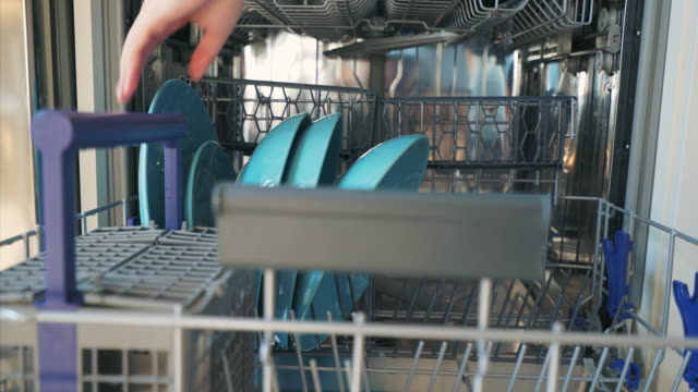 using dishwasher machine. - lavastoviglie video stock e b–roll