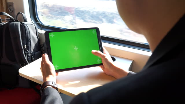 using green screen on a train - digital tablet stock videos & royalty-free footage
