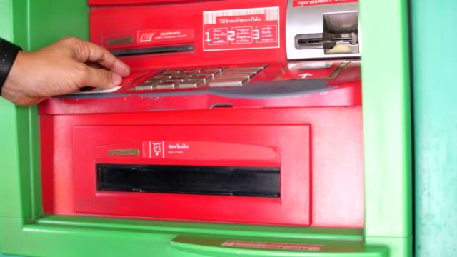 using keypad on automatic telling machine for withdrawing money - pin entry stock videos & royalty-free footage