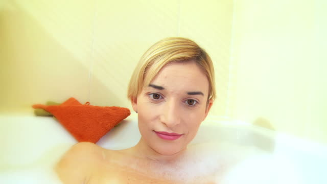 hd: using laptop in the bath - washtub stock videos and b-roll footage