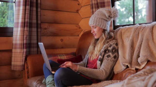 using laptop in the log cabin - cabin stock videos & royalty-free footage