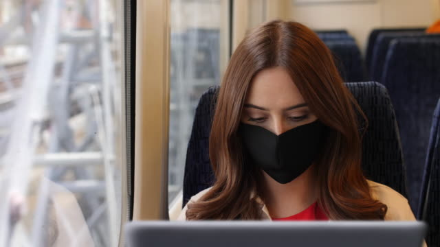 using laptop wearing a face mask, train journey. - only women stock videos & royalty-free footage