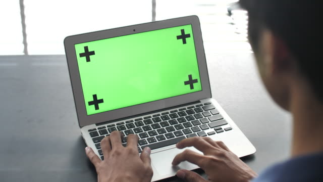 using laptop with green screen - over the shoulder stock videos & royalty-free footage