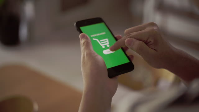 using mobile phone order food delivery - ordine video stock e b–roll