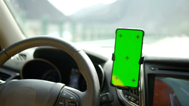using on smart phone with green screen while driving - dashboard vehicle part stock videos & royalty-free footage