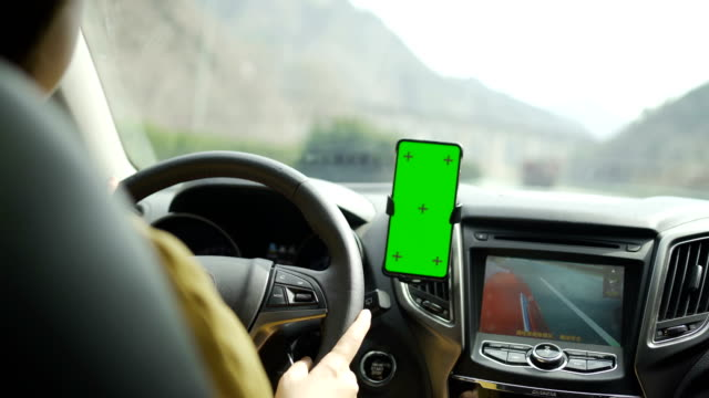 using on smart phone with green screen while driving - dashboard stock videos & royalty-free footage