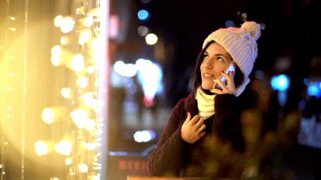 using phone at christmas time - christmas decoration stock videos & royalty-free footage
