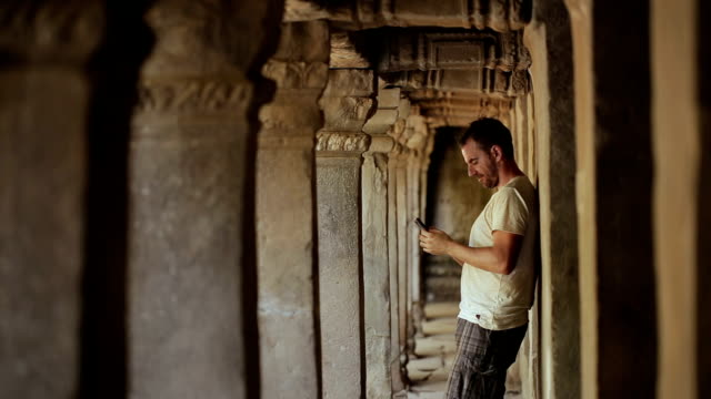Using phone in Angkor Wat