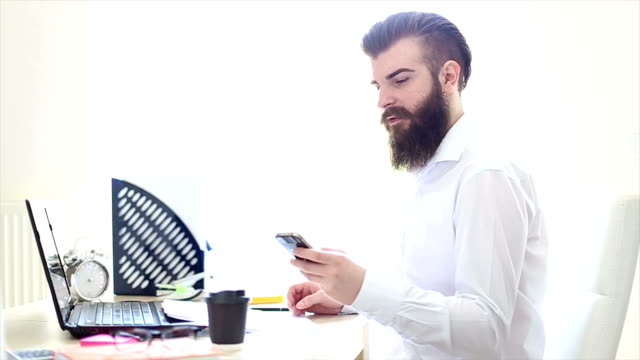 using phone on the work place - metrosexual stock videos & royalty-free footage