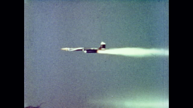 using remote control and cameras the bomarc missile is launched the missile is directed away from its target so the plane can be used for further... - anno 1962 video stock e b–roll