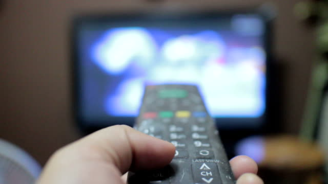 using remote control - cable tv stock videos & royalty-free footage