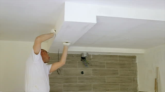 using sand paper on the wall for polishing - sander stock videos & royalty-free footage