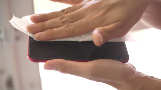 using sanitising wet wipe to clean mobile phone for protect virus - rubbing alcohol stock videos & royalty-free footage