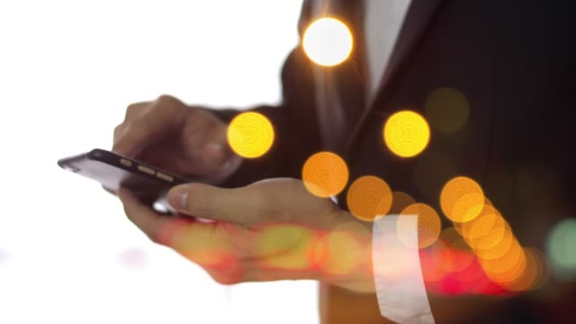 using smart phone bokeh background - business person stock videos & royalty-free footage