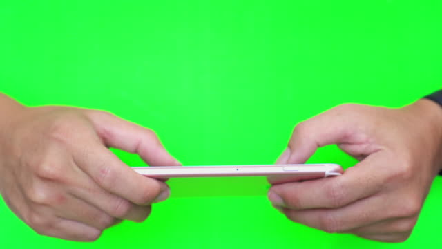 using smart phone green background - thumb stock videos & royalty-free footage