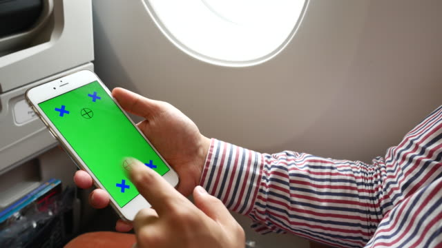 Using Smart phone on Airplane with Green screen, Business Travel