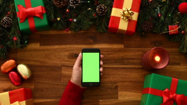 using smart phone on christmas time - elevated view stock videos & royalty-free footage