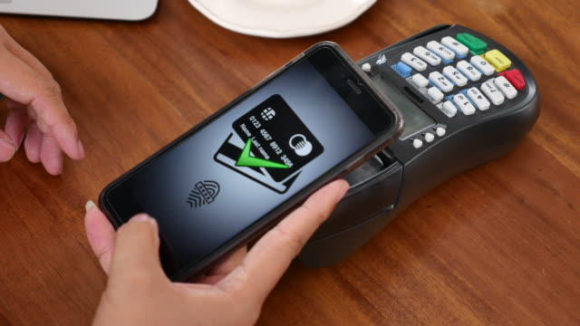 using smart phone paying contactless payment - paying stock videos & royalty-free footage