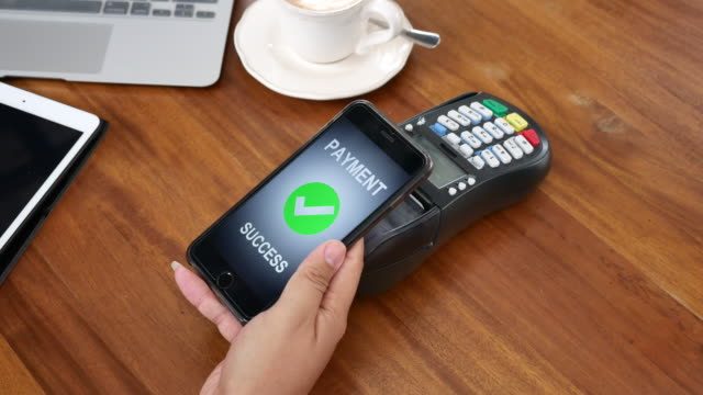 using smart phone paying contactless payment - near field communication stock videos & royalty-free footage