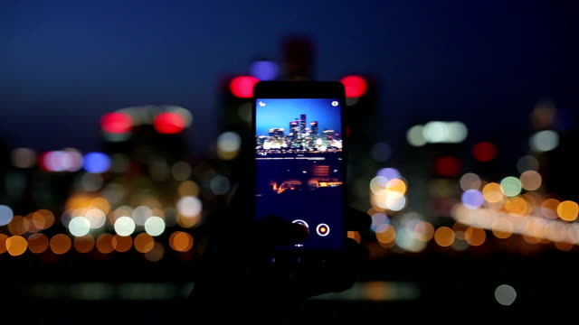 using smart phone take photo in city night - photography stock-videos und b-roll-filmmaterial