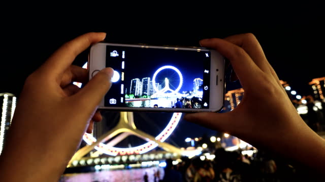 using smart phone take photo in city night - part of stock videos & royalty-free footage