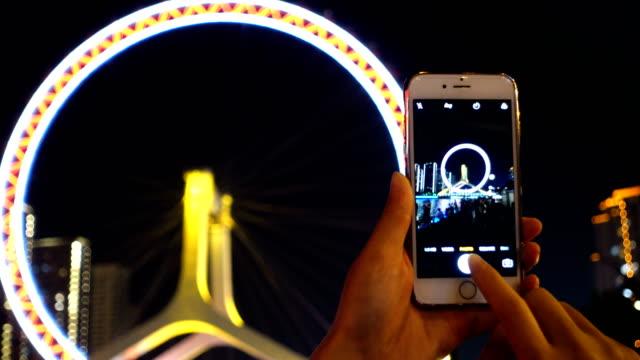 Using smart phone take photo in city night