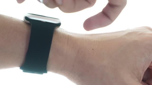 using smart watch - wrist stock videos & royalty-free footage