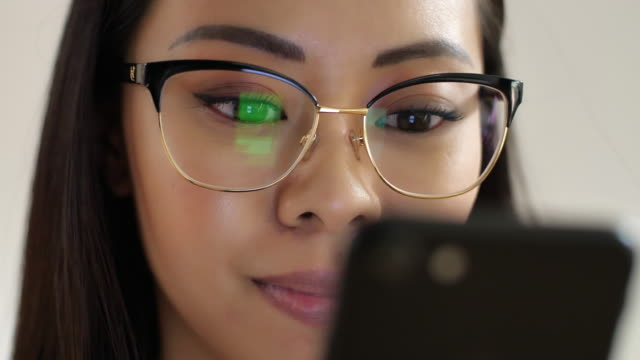 using smartphone close-up. asian woman. - 20 29 years stock videos & royalty-free footage