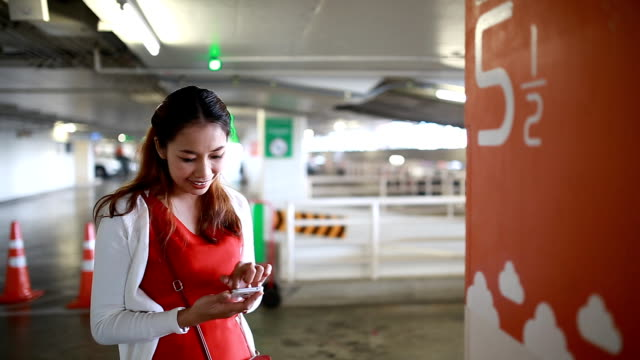 Using smartphone in parking lot.
