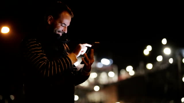 Using smartphone in the city at Night