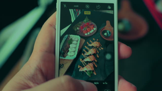 using smartphone taking photo of japanese food - sashimi stock videos & royalty-free footage