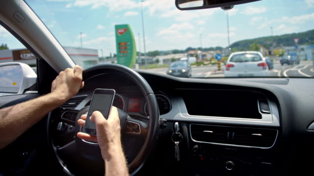 SLO MO Using smartphone while driving in a traffic