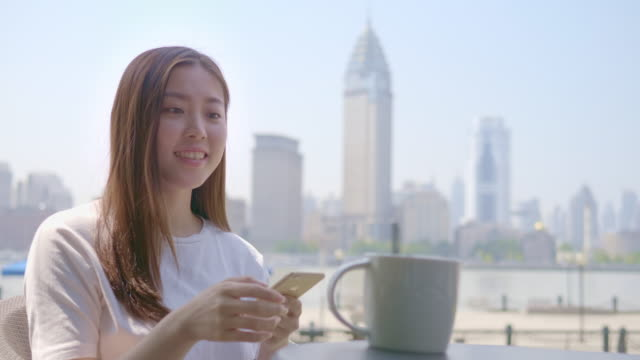 using smartphone, young woman in cafe - gossip stock videos & royalty-free footage