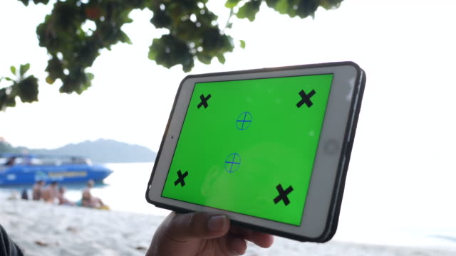using tablet with green screen on beach - close up video stock e b–roll