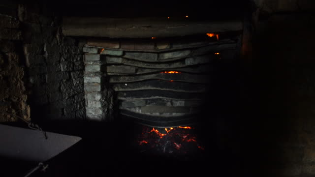 using the husk of rice to burn the bricks in the kilns - industrie ofen stock-videos und b-roll-filmmaterial