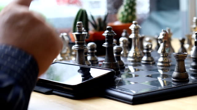 using touch screen phone during play chess