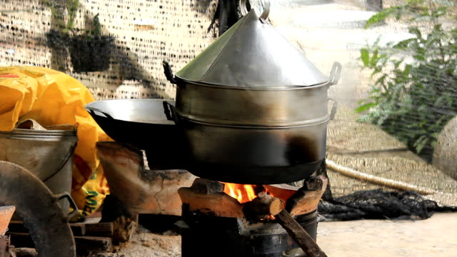 Using traditional cooking stoves.
